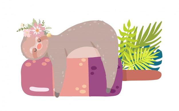 Niedliche trägheit, die auf der eiscreme umgeben durch tropische blätter schläft.