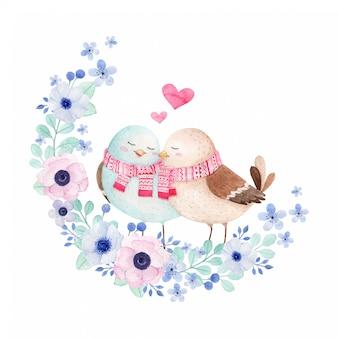 Niedliche vögel in der liebesaquarellillustration mit blumenkranz