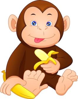 Niedlicher affenkarikatur, der banane hält