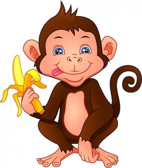 Niedlicher affenkarikatur, der eine banane hält
