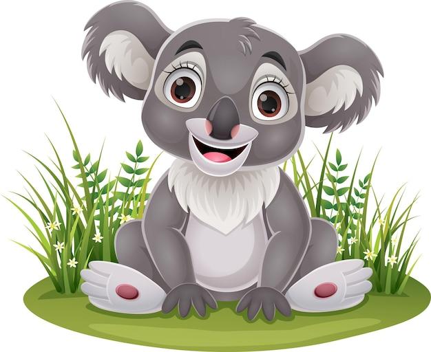 Niedlicher babykoala der karikatur, der im gras sitzt
