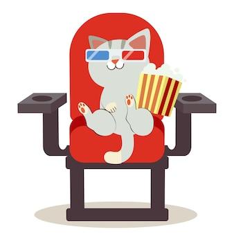 Niedlicher charakter-cartoon der katze sitzend auf dem roten stuhl in einem kino. es sitzt auf einem stuhl und hält eine tüte popcorn.