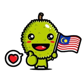 Niedlicher durian, der eine malaysische flagge mit einer guten pose hält