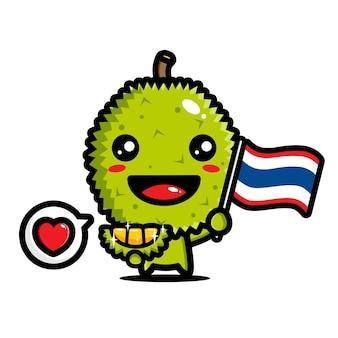 Niedlicher durian, der eine thailand-flagge hält