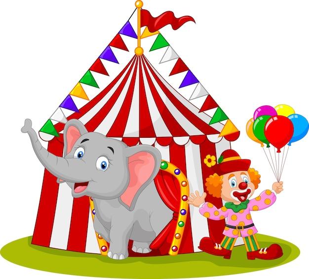Niedlicher elefant und clown der karikatur mit zirkuszelt