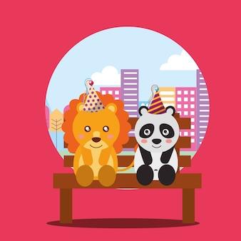Niedlicher löwe und panda, die in der bank die stadt sitzen