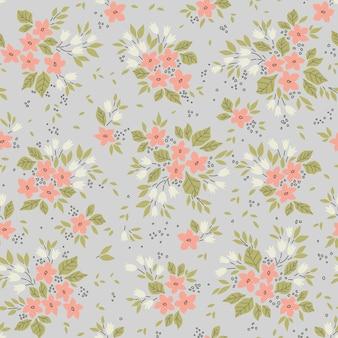 Niedliches blumenmuster in den kleinen rosa blüten nahtloser vektor textur grauer hintergrund