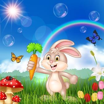 Niedliches kaninchen der karikatur, das eine karotte anhält