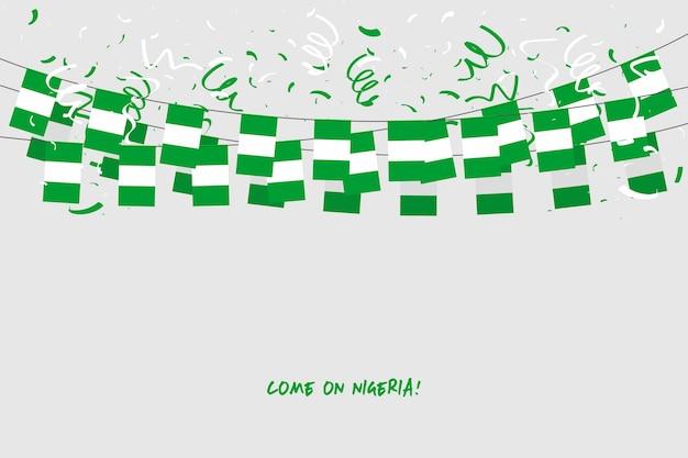 Nigeria-girlandenflagge mit konfettis auf grauem hintergrund.