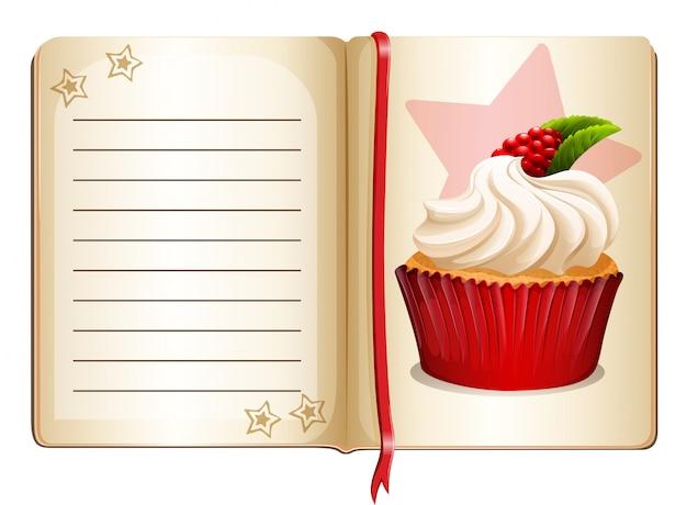 Notizbuch mit kleinem kuchen auf seite
