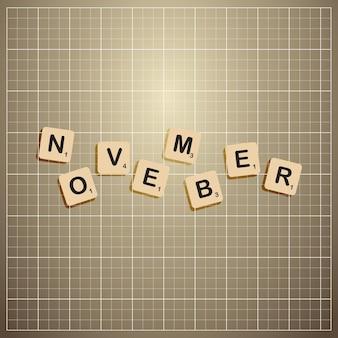 November monat ausgeschnittene buchstaben auf infotafel kleben