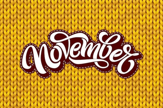 November schriftzug auf gelber strickstruktur. moderne pinselkalligraphie mit nahtlosem strickmuster. schriftzug für grußkarte, social media banner, druck. illustration.