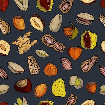 Nüsse nahtlose muster haselnüsse kastanien erdnüsse walnüsse pistazien auf dunkelblauem hintergrund