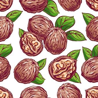 Nüsse. nahtloser hintergrund mit walnuss und blättern. handgezeichnete illustration