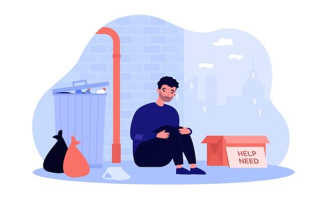 Obdachloser armer mann, der an straße nahe kastenillustration sitzt. karikatur verzweifelte, schmutzige und hungrige person nahe müll. wohltätigkeits- und bedürfniskonzept