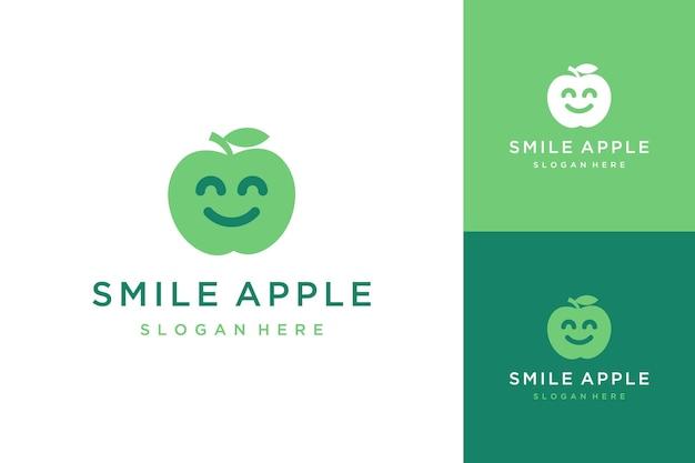 Obst- oder apfeldesign-logo mit einem smiley-gesicht
