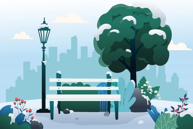 Öffentlicher park mit bank im winter.