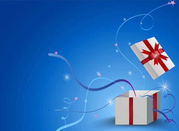 Öffnen sie geschenkbox mit band auf blauem hintergrund.