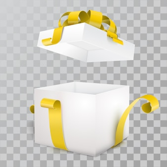Offene geschenkbox und mit gelbem bogen und band