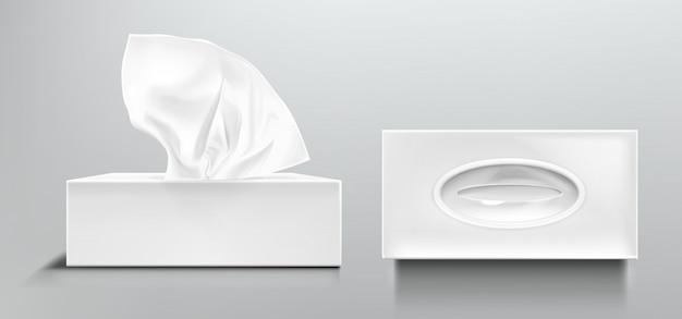 Offene und geschlossene schachtel mit weißen papierservietten