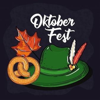 Oktoberfestfestfeier mit tiroler hut, brezel und herbstblatt