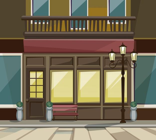 Old europian shop boutique museum restaurant cafe ladenfront mit großen fenstern, platz für namen, grün, straßenlaternen und pflastersteinen