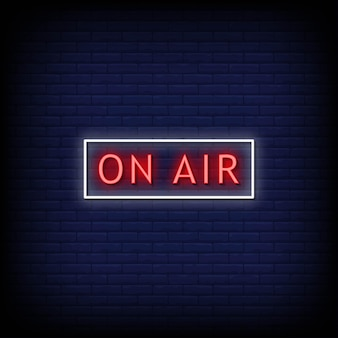 On air neon signs style text an der blauen wand