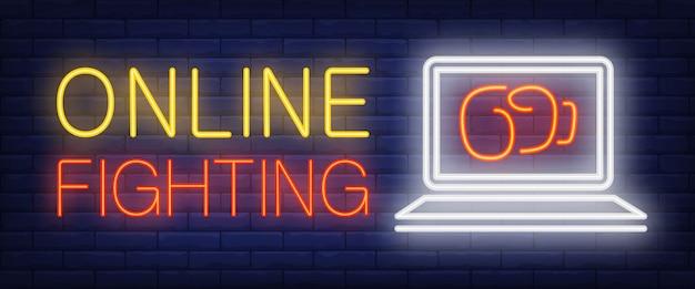 On-line-kämpfender neontext mit boxhandschuh auf laptopbildschirm