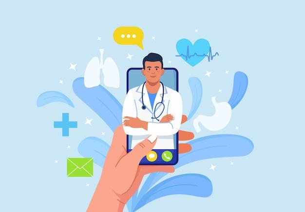 Online-arzt. virtuelle medizin. mobile app für den anruf beim arzt. arzt fragen. gesundheitsberatung, diagnose. handy in der hand halten