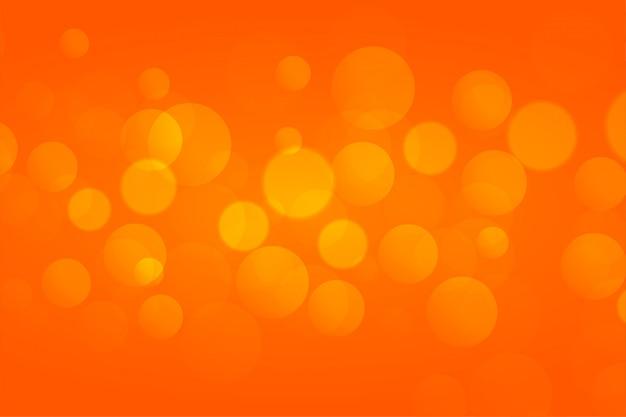 Orange bokeh beleuchtet hintergrund mit text soace