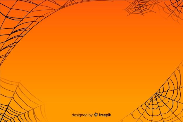 Orange halloween-spinnennetzhintergrund