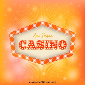 Orange hintergrund mit licht zeichen des casinos