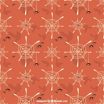 Orange spinnennetze muster