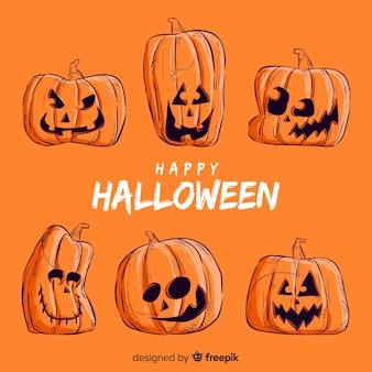 Orange und schwarze hand gezeichnete halloween-kürbissammlung