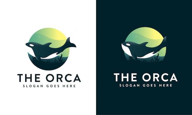 Orca unter dem meereslogo Premium Vektoren