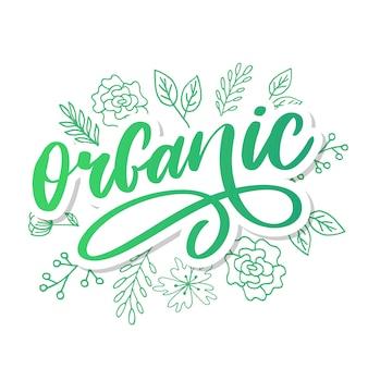 Organische pinselschrift. hand gezeichnetes wort organisch mit grünen blättern. etikett, logo-vorlage für bio-produkte, gesunde lebensmittelmärkte.