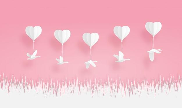 Origami-ballone mit vogelknickente und gras