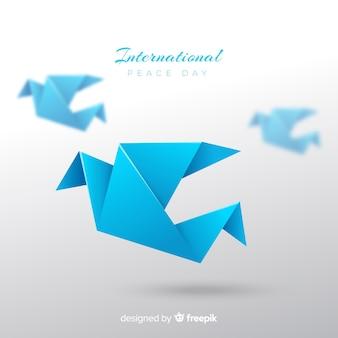 Origami friedenstageshintergrund mit taube