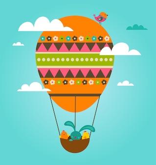 Osterkarte mit einem osterhasen in einem bunten heißluftballon