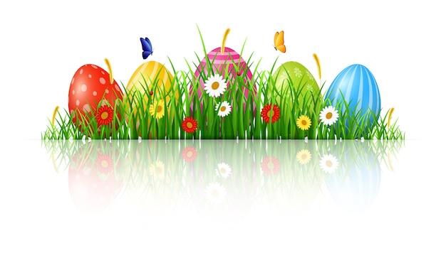 Ostern-hintergrund mit eiern im gras Premium Vektoren