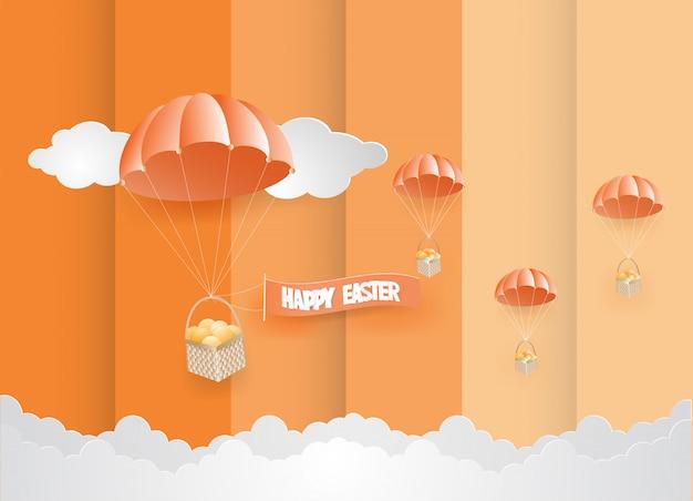 Ostern-tageskarten-designschablone ärgert im korb, der mit weißem seilfallschirm auf orange himmel gebunden wird