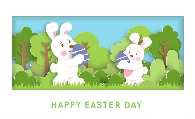 Ostertageskarte mit niedlichen kaninchen und ostereiern