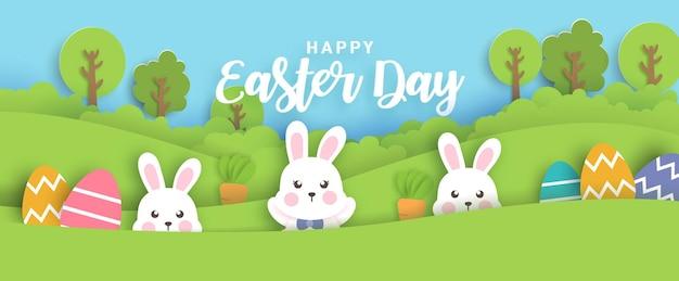 Ostertagskarte mit niedlichen kaninchen und ostereiern.