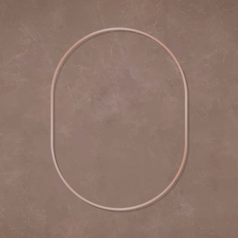 Ovaler bronzerahmen auf braunem hintergrund