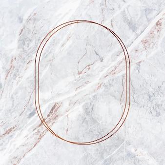 Ovaler kupferrahmen auf grauem marmorhintergrund