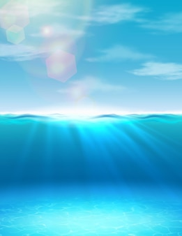 Ozeansommer unterwasserhintergrund mit sonnenlicht und strahlen