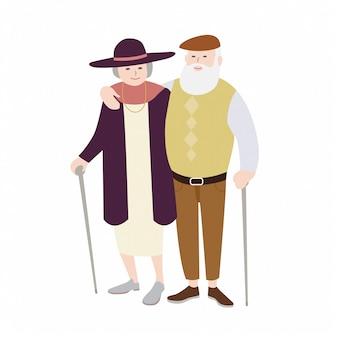 Paar alter mann und frau gekleidet in stilvoller kleidung, die mit stöcken steht und sich umarmt. älteres liebespaar. flache zeichentrickfiguren lokalisiert auf weißem hintergrund. illustration.