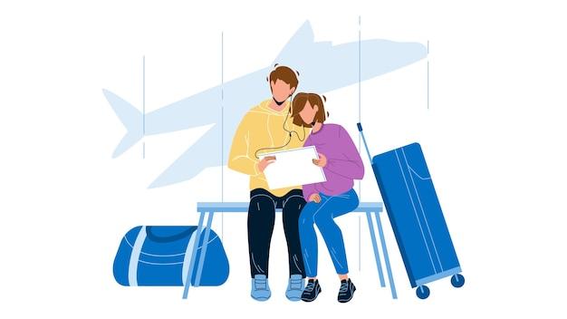 Paar, das flug im flughafenterminal wartet
