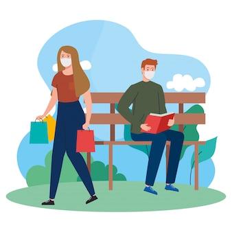 Paar, das medizinische maske, frau trägt einkaufstaschen und mann liest buch, auf im freien trägt