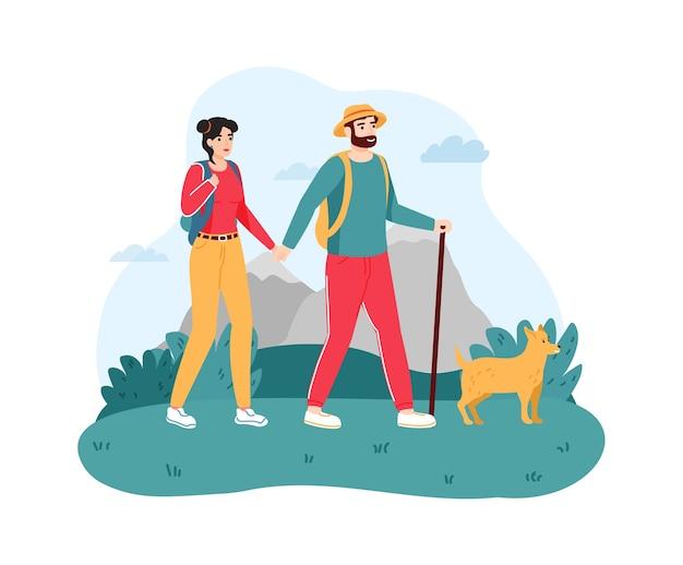 Paar, das mit hund reist. junger mann und frau, die auf natur mit stock wandern oder wandern.